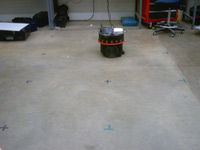 floor with marks on it and robot in background
