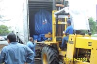 Forklift loading rover into the truck